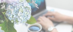 beautify flowers and a woman on a laptop