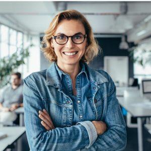 woman in denim shirt and glasses
